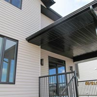 A finished siding job with soffit, cladding and eaves